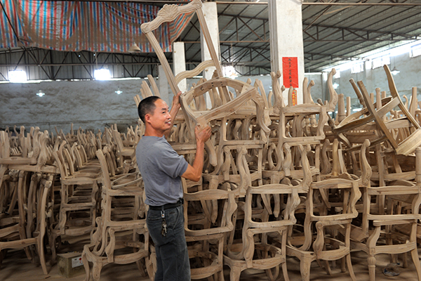 Guangdong 39 s boomtown dongguan gets technological upgrade 1 for Furniture factory