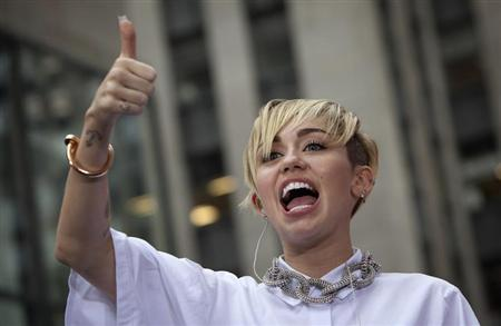 Miley Cyrus grabs top slot in UK single and album charts