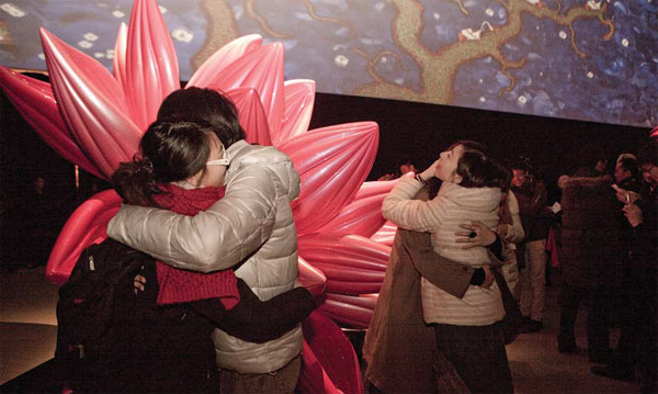 A Project Organized By Today Art Museum Asks The Participating Pairs To Embrace Each Other For
