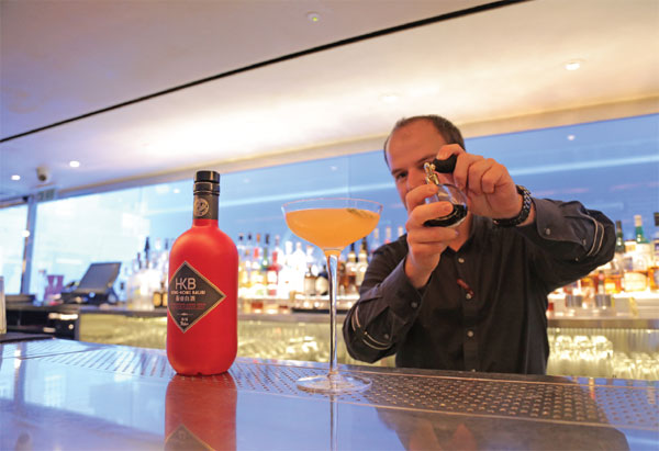 A Bartender Makes Baijiu Based Cocktail In Central London