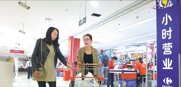 Genes Can Have Up To 80 Percent >> two customers head for the exit after shopping at a 24 hour carrefour supermarket in shanghai ...