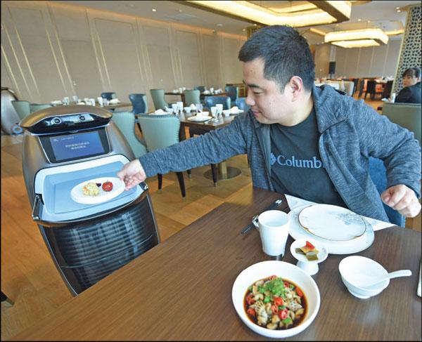 A Robot Waiter Serves In A Restaurant In Hangzhou Zhejiang